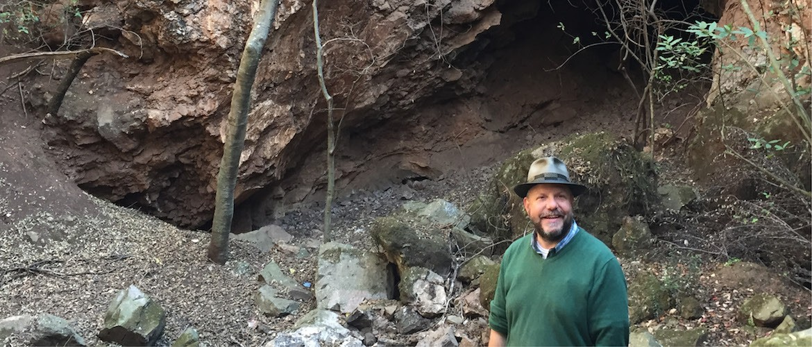 John Hawks near Rising Star cave in South Africa, where Homo naledi was found. Credit: Kelly Tyrrell