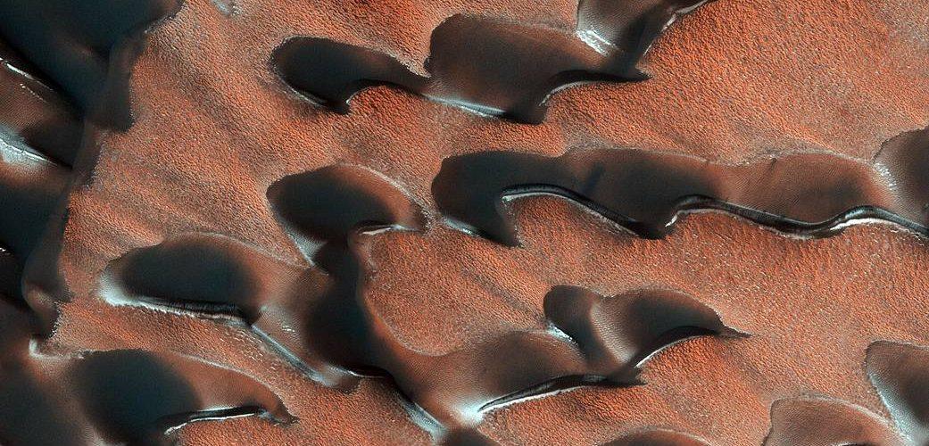 NASA's Mars Reconnaissance Orbiter (MRO) observed sand dunes in the north polar regions of Mars.