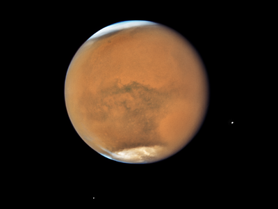 NASA's Hubble Space Telescope photographed Mars on July 18, 2018, near its closest approach to Earth since 2003. The planet was observed near opposition, when the Sun, Earth and Mars are lined up, with Earth sitting in between the Sun and Mars. This proximity gives the Red Planet its brightest appearance in the night sky since the 2003 opposition.
