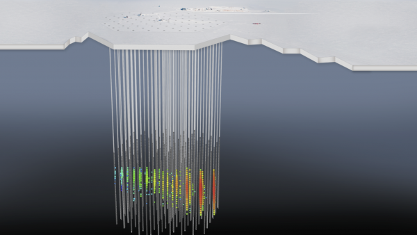 A representation of the September, 2017 neutrino event in IceCube. The strings carry sensitive light detectors, and those detectors that captured the neutrino event are in color.