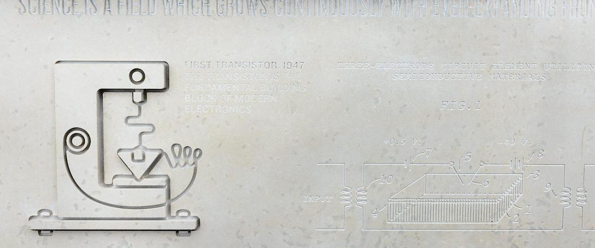 A panel of etched stone honoring John Bardeen's development of the transistor, an electrical device that earned Bardeen the first of two of his Nobel Prizes, is one of many graphics and informational displays featured at Alumni Park at the University of Wisconsin-Madison on Aug. 26, 2017.